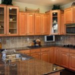stunning wooden furnished kitchen design with natural cabinetry design with kitchen bar and glossy marble countertop