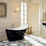 stylish black victoria and albert tub design with patterned tile flooring ides and cream wall and wonderful wall mirror and unique vanity
