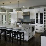 stylish large kitchen islands with seating and storage with black wooden stool and hardwood floor plus modern pendant lighting plus white kitchen cabinets