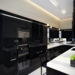 total black kitchen cabinet with white countertop and modern appliances in contemporary kitchen design