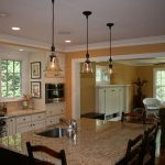 Traditional Kitchen Remodeling Northern Va With White Wooden Kitchen Cabinets And Kitchen Island With Granite Countertop And Wooden Chairs Plus Pendant Lamp