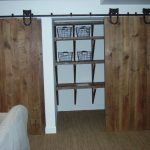 traditional sliding barn doors for closets in wooden combined with rug flooring and wooden shelves on wall