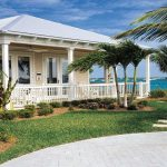 tropical home design with large porch in Key West style