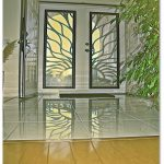 two swing panels security doors with transparent and paint natural patterns glass panels