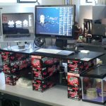 unique and creative standing desk design with black countertop and red coke pattern for the legs aside plastic box