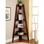 unique corner bookshelf design with wooden material with pyramid shape aside decorative plant beenath creamy wall