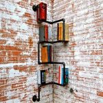 unique industrial metal corner bookshelf design in black tone on brick wall with red and white combination