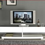 unique modern white tv consoles with books and metal legs and grey rug area