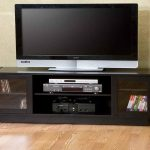 unique wooden tv consoles for flat tv with glass door cabinets and media and book storage and cool wallpaper and wooden laminating floor