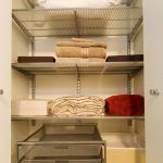 vertical linen closet organizer design in neutral white tone with transparent racks with drawers and box