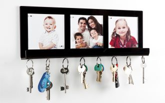 wall mounted key holders for wall with family pictures in frame