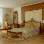 warm and classic bedroom style with a bed furniture with classic headboard a settee furniture a set of dressing furniture a reading chair a pair of wood bedside tables a Turkish rug