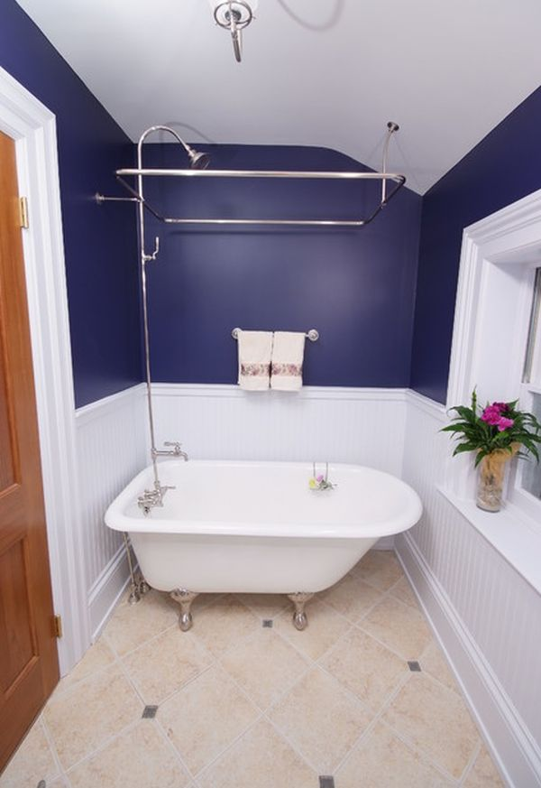 White Ceramic Bathtub With Showers And Towel Holder In Blue Wall Scheme And  Tiled Floor In. Having A Small Bathroom ...