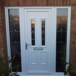 white paint wood security door with narrow viewable screen and a pair of sidelights on left and right sides of door