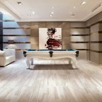 white washed granite floor system for contemporary home interior design a billiard yard table in white construction a pure white sofa an abstract painting as wall decoration