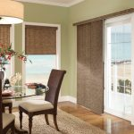 window covering for sliding glass door in dining room with blinds combined with glass table and beautiful dining chairs plus jute rug on wooden floor
