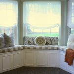 window coverings for bay windows with white drapery plus bench with striped motif and cute cushions and rug flooring