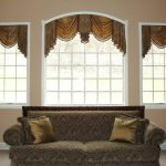 window treatments for wide windows with brown valance and brown sofa and cushions for living room