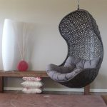 wonderful black net hanging chair for comfy bedroom seating with gray tufted and tender bolster upon cream rug aside wooden bench with white ceramic