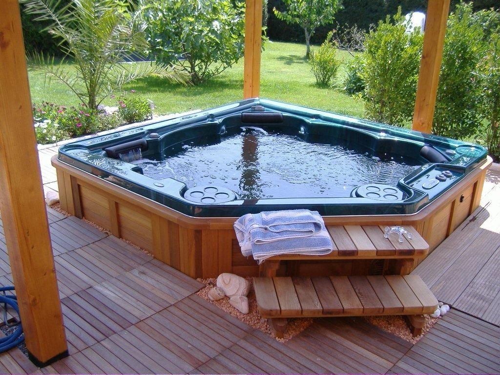 wonderful geometrical built in hot tub design with wooden deck with wooden pillars with wooden staircase aside greenry - Hot Tub Design Ideas