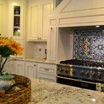 wonderful spanish tile backsplash design upon cooktop beneath smokestack before white patterned marble kitchen island top with sunflower