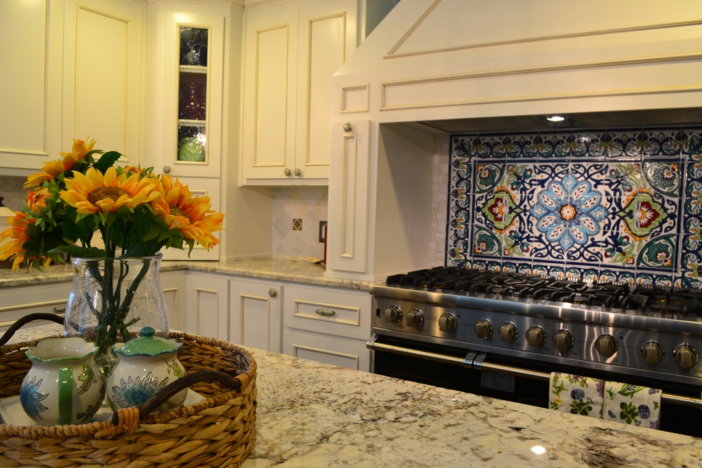 Wonderful Spanish Tile Backsplash Design Upon Cooktop Beneath Smokestack Before White Patterned Marble Kitchen Island Top