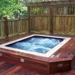 wonderful wooden built in hot tub design with white accent and wooden patio deck with bamboo fence