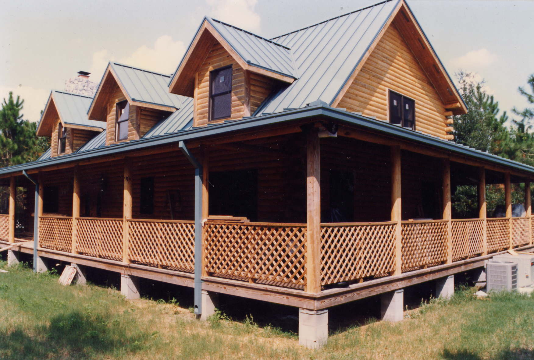 Wood Country Home Style With Wrap Around Porches Equipped With Wood Lattice  Railing System