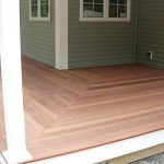 wood planks floor system for front porch without railings wood planks wall system in grey white window trims and moldings white log porch's pillars