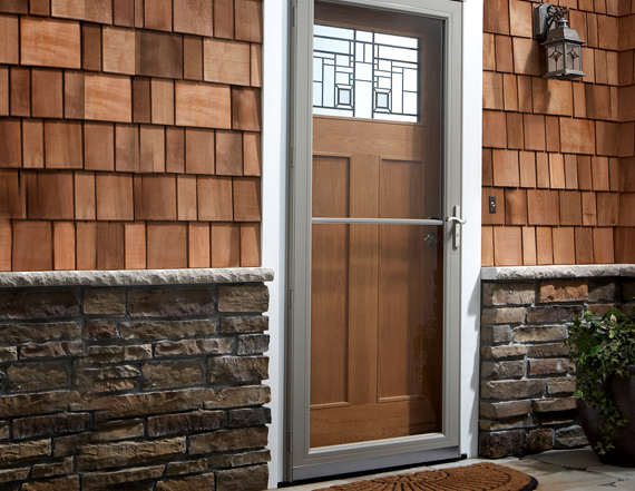 wood screen door with upper glass panel half way wood wall system with  natural stones as - Unique Home Designs Screen Doors: Buying Guide HomesFeed