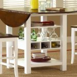 wooden drop leaf dining table for small spaces with stunning wooden chairs and soft rug on floor plus wine storage under the table