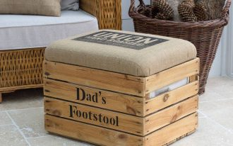 wooden file storage ottoman design with gray bolster idea and beige tone upon concrete floor before rattan sofa and basket
