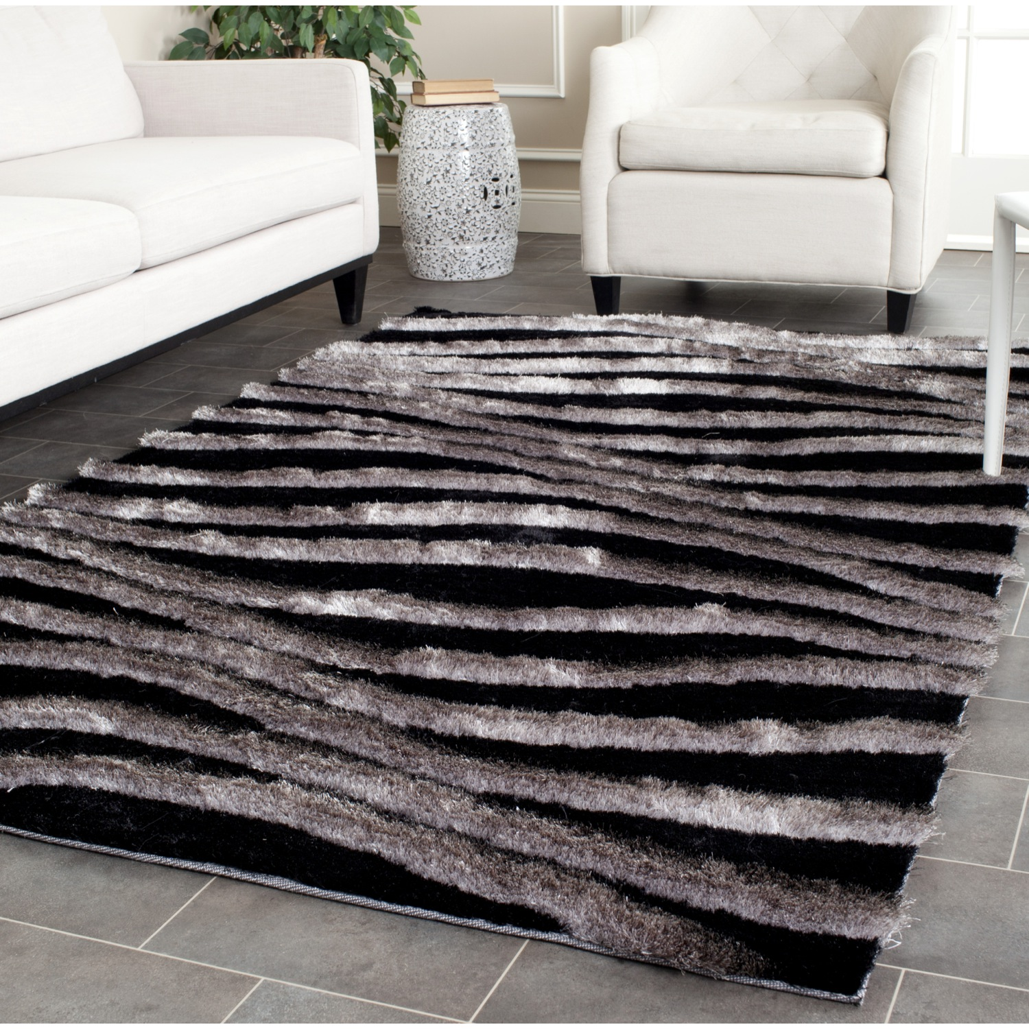 3d black and gray area rugs in awesome pattern for modern living room ideas with white leather sofa and armchair plus subway tile floor