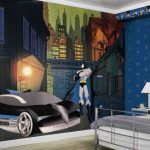 A bedroom with Batman theme with metal bed furniture blue wall with small Batman stickers