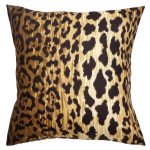 A throw pillow with artificial tiger's skin motif for its cover