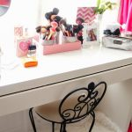 A Vanity Organization Idea With Cute Glasses For Organizing Face Brushes Collections A Small Decorative Mirror A Decorative Flat Container For Storing The Perfumes