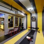 Basement decorating idea for fitness center and mini bar with bar table plus barstools
