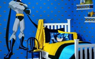 Batman bedroom idea with white paint color bed furniture Batman pillow case Batman wallpaper yellow and blue bedding a small black chair and monochrome rug