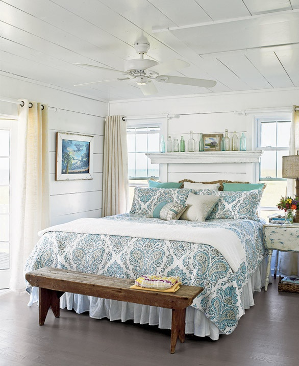 Beach Bedroom Design With Blue Motifs On Bed Cover And Pillows White  Blanket Old Look Wooden