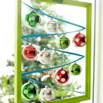 Beautiful and colorful Christmas balls for windows framed with green square structure