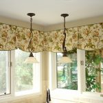 Beautiful corner window curtain two pendant light fixtures over the sink