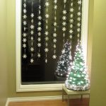 Beautiful hanging Christmas decorations with mini Christmas tree beautified with ornamental lighting