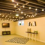 Beautiful industrial light fixtures for basement that includes simple media desk with floating flat TV some barstools for organizing decorative plants medium-size rug with modern pattern