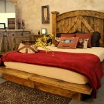 Beautiful rustic bedroom idea with rustic platform bed plus rustic headboard rustic credenza a pair of rustic bedside tables darker brown bedroom rug with floral pattern