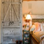 Bedroom decor in rustic style with platform bed with storage a barn door green small bedside table wall light fixture