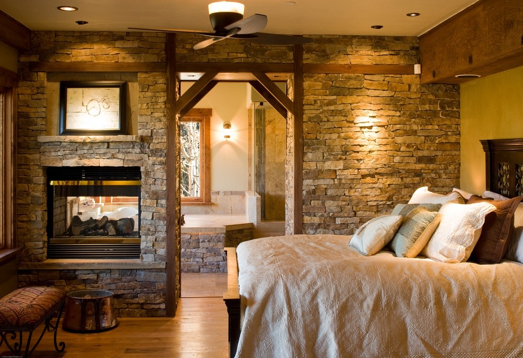 Bedroom decorating idea in rustic a wood bed furniture with crafted wood  headboard bricks wall system
