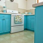 Bright turquoise cabinets large gas stove white ceramic floors with accent