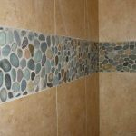 Brown ceramic tile idea with natural stones accent for a modern shower