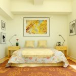 Classic bedroom rug with artistic floral pattern queen bed furniture without headboard a pair of lighter brown stained wood side tables with modern table lamps beautiful nature painting in frame