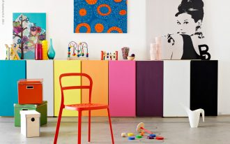 Colorful boxes as the small storage made from IKEA some boxes as the storage a red plastic chair kids' toys some artistic paintings for wall system